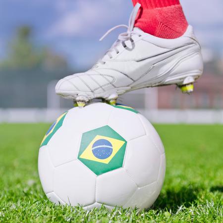 uniform green shoe: Ready to kick-off, ball with Brazilian flag Stock Photo