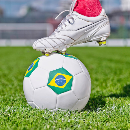 kick off: kick off time - Soccer shoe ready to kick the ball with Brazilian flag