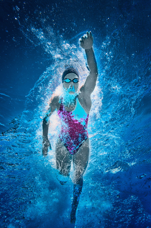toned image: Front crawl swimmer. Underwater view, toned image