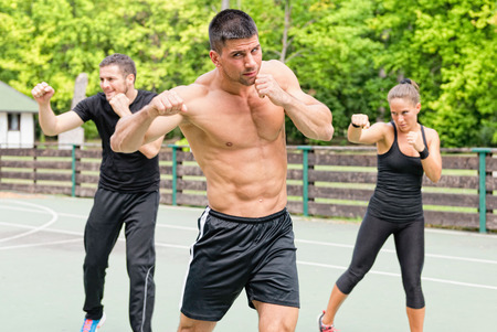 cardiovascular workout: Tae Bo training outdoors