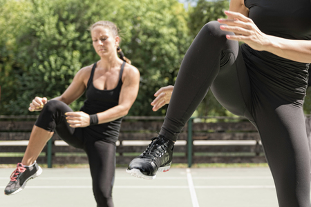 cardiovascular workout: Keep ups, group of people exercising outdoors Stock Photo