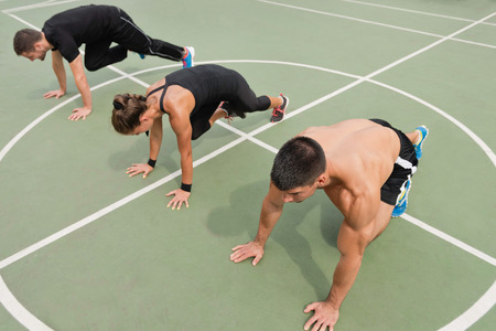 cardiovascular workout: Mountain climbers workout, exercise class Stock Photo