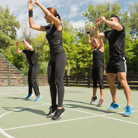cardiovascular workout: Aerobics, group of people in vigorous exercise Stock Photo