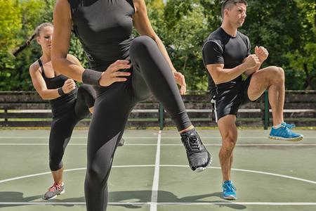 cardiovascular exercising: Outdoors exercise class Stock Photo