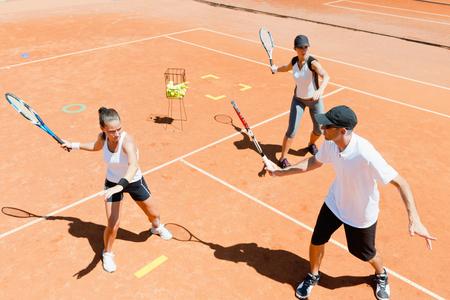 forehand: Tennis instructor explaining forehand on training Stock Photo