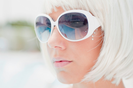 jewlery: Fancy blonde girl with white sunglasses. High key, shallow depth of field