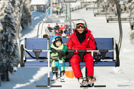 ski lift: Father and son on ski lift