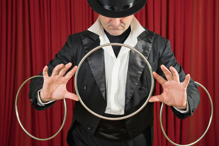 magic trick: Magician performing a classic magic trick with rings