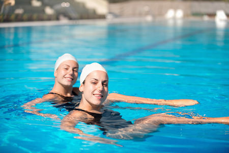 duet: Synchronized swimming duet performing in swimming pool Stock Photo