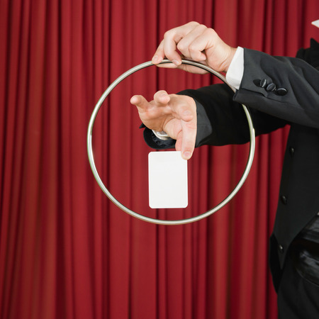 magic trick: Magic trick with ring and blank card, convenient for your content Stock Photo