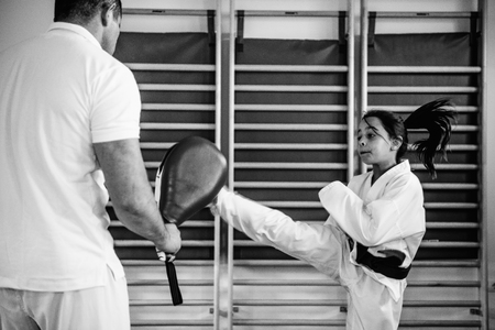 tae: Tae kwon do instructor working with girl