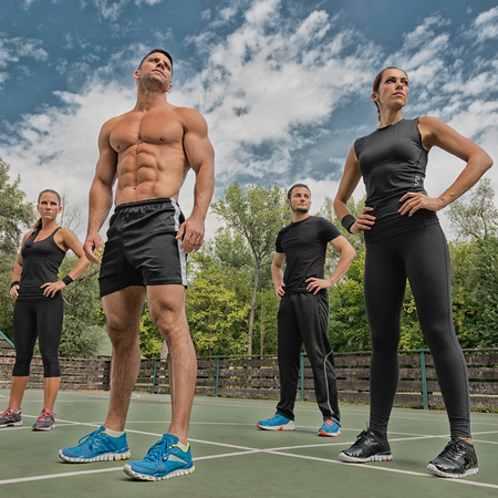 cardiovascular workout: Fitness team of four athletes posing