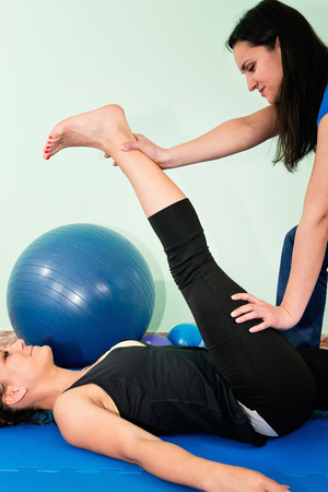 only two people: Physical therapist working with female athlete