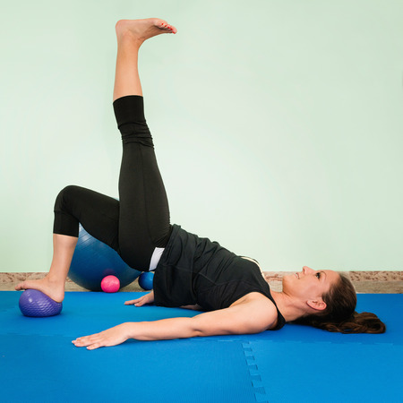 fitness ball: Young female athlete exercising with fitness ball
