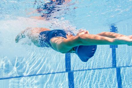 backstroke: Backstroke swimming woman pushes herself of the wall