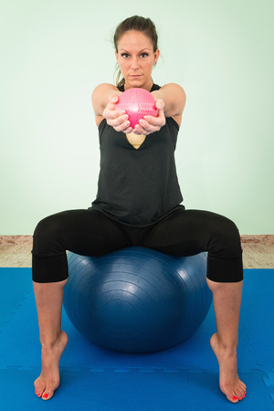 front view: Exercise with fitness ball, front view