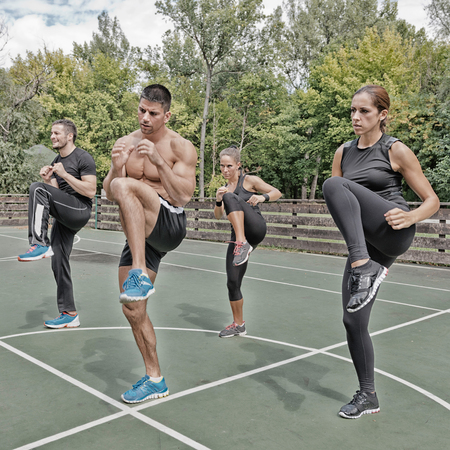 cardiovascular workout: Tae Bo team doing keep up exercise in training