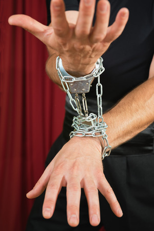 restrained: Hands in chains, low key