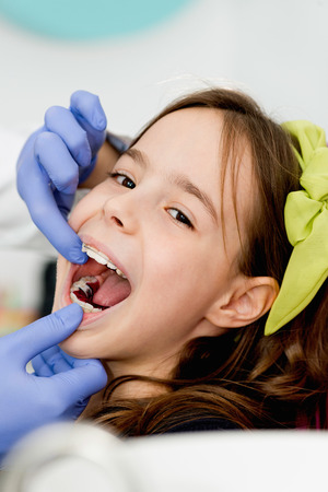 orthodontist: Cute little girl with braces at orthodontist