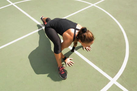 insanity: Young woman exercising on basketball court floor, insanity workout
