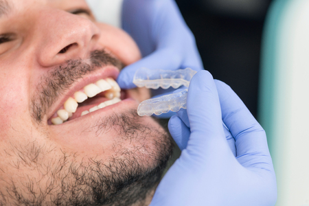 invisible: Smiling male patient trying invisible braces Stock Photo