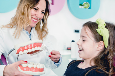 Little girl at dentist, talking about dental hygiene Stock Photo