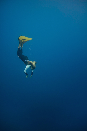 free diving: Female free diver diving down