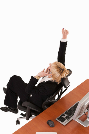 winning mood: Business woman in the winning mood. Isolated on white, clipping path included.