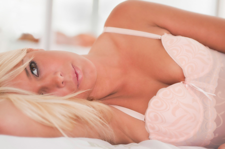 daydreaming: Attractive girl in lingerie daydreaming