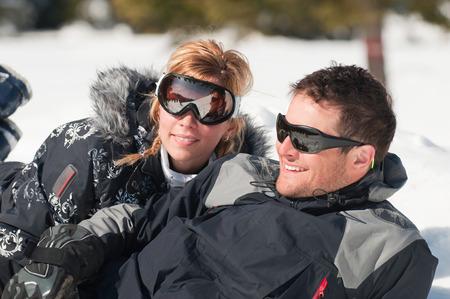 couple winter: Young happy couple enjoying winter sunlight Stock Photo