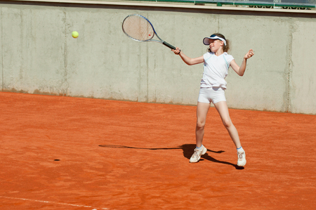 forehand: Junior tennis player hits a forehand Stock Photo