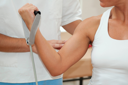 two person only: Physiotherapist and female patient with strengthen arm Stock Photo