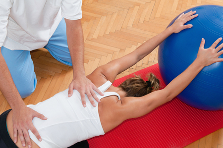 stratching: Physiotherapist working with an athlete on back stratching
