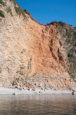 landslide: Landslide on the coast. Rare natural phenomenon usually caused by erosion or earthquake. Stock Photo
