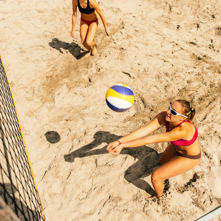 volleyball team: Female beach volleyball team in action