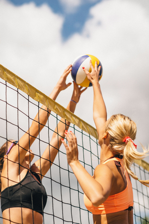 two persons only: Beach Volleyball Girls On The Net Stock Photo