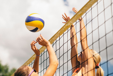 two persons only: Beach Volleyball Duel on the Net Stock Photo
