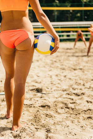 Beach volleyball - attractive girls preparing to serve Stock Photo
