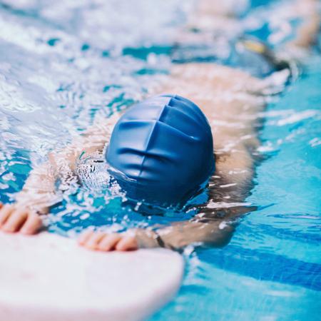 little boy swimming: Little boy swimming with kicking board
