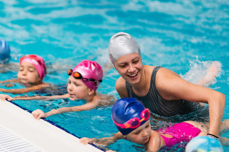 Swimming school - Swimming instructor with children 스톡 콘텐츠
