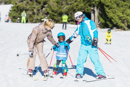 Family skiing on winter vacation