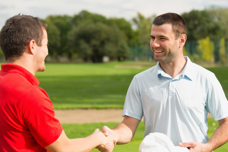 congratulating: Golfers congratulating after the game Stock Photo