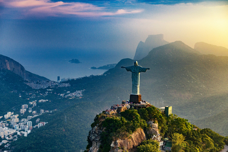 Christ The Redeemer statue in Rio De Janeiro. Sunset, shot from the helicopter