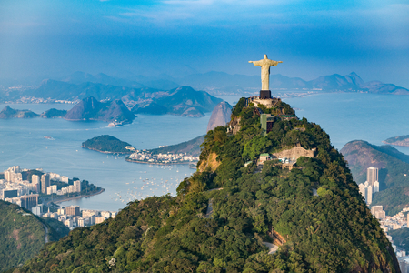 Aerial view of Rio De Janeiro. Corcovado mountain with statue of Christ the Redeemer overlooking Rio De Janeiro landscape. Photographed from helicopter.