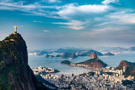 Aerial view of Rio De Janeiro. Corcovado mountain with statue of Christ the Redeemer, urban areas of Botafogo and Centro, Sugarloaf mountain.