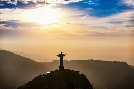 redeemer: Christ The Redeemer statue in Rio De Janeiro. Aerial view, sunset time