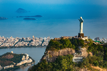 Statue of Christ the Redeemer overlooking city of Rio De Janeiro. Aerial view, shot from helicopter.