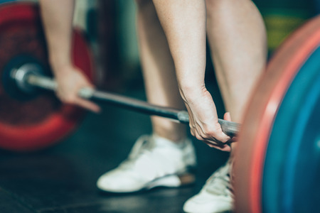 snatch: Female on weightlifting training