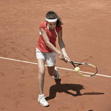 Junior female playing tennis