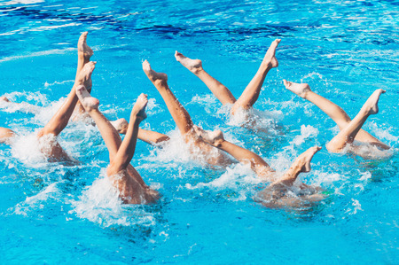 competitive: Synchronized swimmers performance with legs outside water